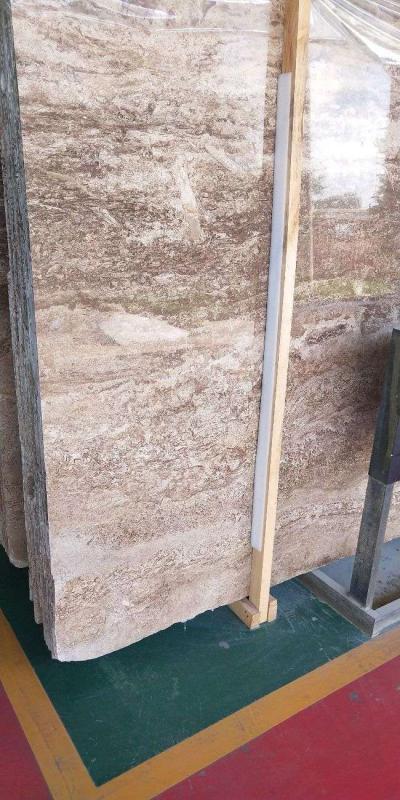 米白洞石。五件,240平方底价处理。————米白洞石荒料6颗90吨。特价。————凯撒灰1200平方处理。————咖啡洞石,米黄洞石,全部1点八厚度5000平方。处理15259420176